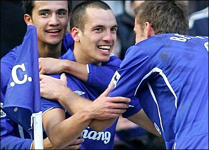 Tim Cahill and James Beattie congratulate Leon Osman after scoring the third