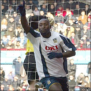 Lomana LuaLua salutes the crowd after scoring the first goal