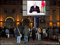 A giant TV screen shows Alexander Lukashenko's speech on a Minsk street