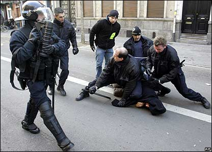 Riot police tackle demonstrator in Lille