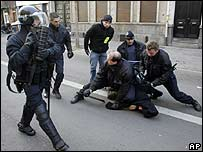 French police arrest a student during a demonstration in Lille