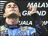 Giancarlo Fisichella savours the moment on the podium after his Malaysian Grand Prix victory