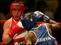TJ Hamill fends off a shot from Kenya's Absolom Okoth in Sunday's bout