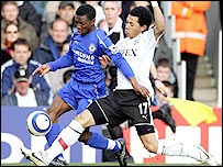 Chelsea's Shaun Wright-Phillips is tackled by Fulham defender Liam Rosenior