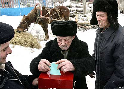 Man placing vote in ballot box