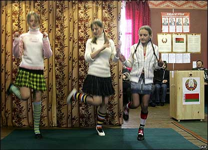 Schoolgirls dancing in polling station