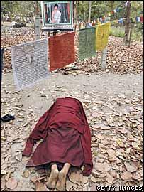 Follower prays where Ram Bomjan has been meditating
