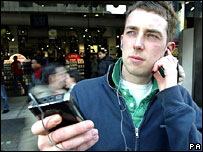 Man listening to music on MP3 player
