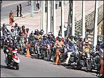 Motorcycles queue up at a petrol pump in Kathmandu