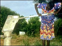 Woman pumps water from standpipe.  Image: BBC