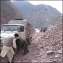 A car stuck in a landslide in Neelum Valley