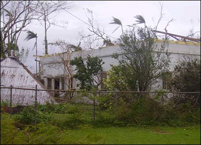 A telephone pole falls on a house (picture courtesy of Stieve De Lance)