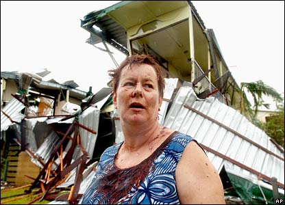 Innisfail resident Kate Charleston stands outside her destroyed house