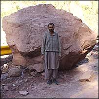 A rock on a road in Jhelum Valley