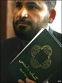 Trial judge Ansarullah Mawlazezadah holding the bible he says belonged to Abdul Rahman