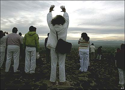 Pilgrims on top of the Pyramid of the Sun in Teotihuacan, Mexico