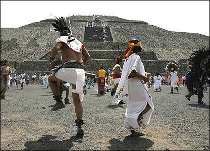Performers dressed as Aztecs perform the dance of the four winds around the Sun Pyramid at the Teotihuacan site
