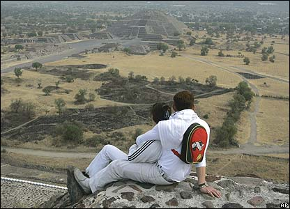 A couple observe the Pyramid of the Moon on top of the Pyramid of the Sun in Teotihuacan, Mexico on Monday, March 20, 2006.