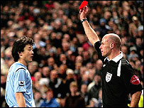 Man City's Sun Jihai is shown the red card by referee Howard Webb