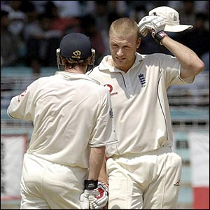 England's Andrew Flintoff and Paul Collingwood chat between overs