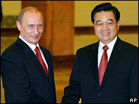 Vladimir Putin and Hu Jintao after the talks in Beijing