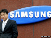 South Korean walking past Samsung sign