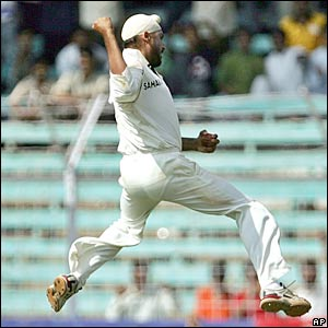 Harbhajan Singh celebrates dismissing England's Paul Collingwood
