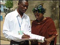 Nigerians filling in census form