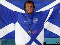 Gregor Tait celebrates his gold medal
