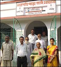 Staff standing outside the Narapatipara High Madrassa
