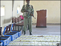 A Kenyan soldier guards seized cocaine