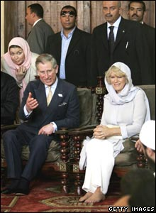 Prince Charles and Camilla with a group of dignitaries inside the mosque