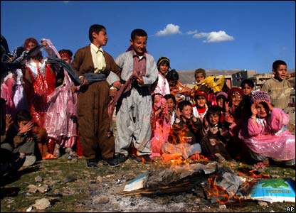 Kurdish children gather around a fire in Kirkuk, northern Iraq