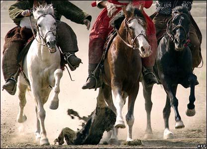 Afghan horseman play Buzkashi