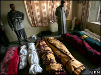 Relatives gather around the shrouded bodies of people they say were civilians killed by US marines in Haditha, Iraq on Monday, Nov 21, 2005