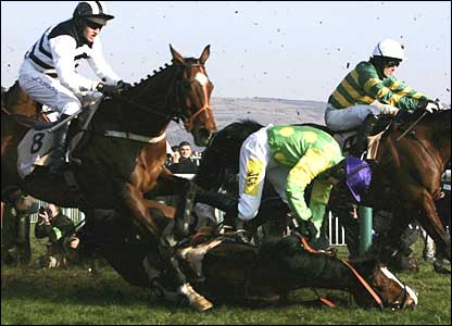 Jockeys try to avoid a pile-up after Ruby Walsh falls from Kauto Star