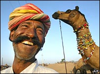 Man with camel in Pushkar Mela, Rajasthan