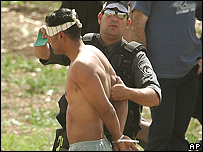 Ten Palestinians were arrested, stripped and handcuffed