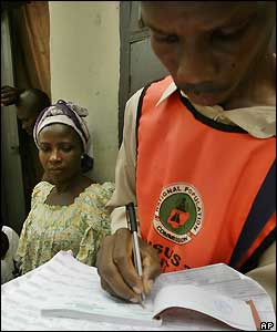 A Nigerian National Population Commission official records people counted in Lagos