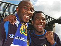 Jason Roberts (left) celebrates Wigan's promotion last season