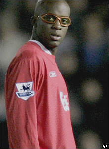 Liverpool midfielder Mohamed Sissoko takes to the field in protective glasses after an injury against Benfica threatened his sight