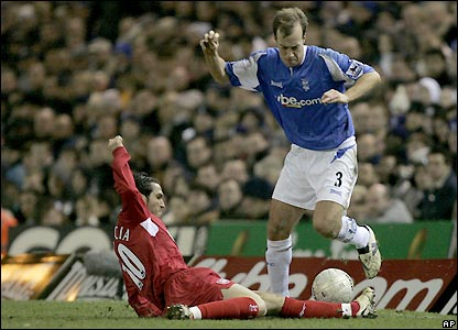 Jamie Clapham is tackled by Luis Garcia