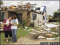 Residents stand outside their destroyed home in Kurrimine Beach, Queensland