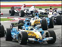 Renault's Giancarlo Fisichella leads the field on his way to victory in the Malaysian Grand Prix