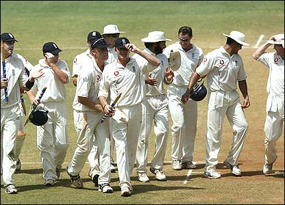 England's players celebrate after completing a memorable 212-run victory
