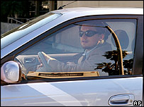Actor Leonardo DiCaprio drives a Toyota Prius hybrid car