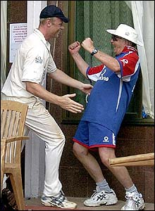 Flintoff celebrates with England coach Duncan Fletcher