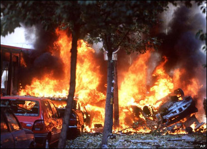Flames rise after a car bomb explodes in central Madrid, October 30, 2000