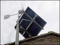 Home-scale wind turbine and solar panel.  Image: BBC