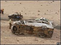 Police inspect the wreckage of the bus which crashed near Arica, Chile (pic AP/Diario La Estrella)